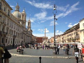 This is a photo of Piazza Novona, blue skies beautiful architecture in rome italy