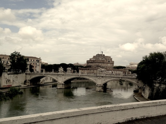 Overlooking st angelo from the bridge of the rive the river in rome