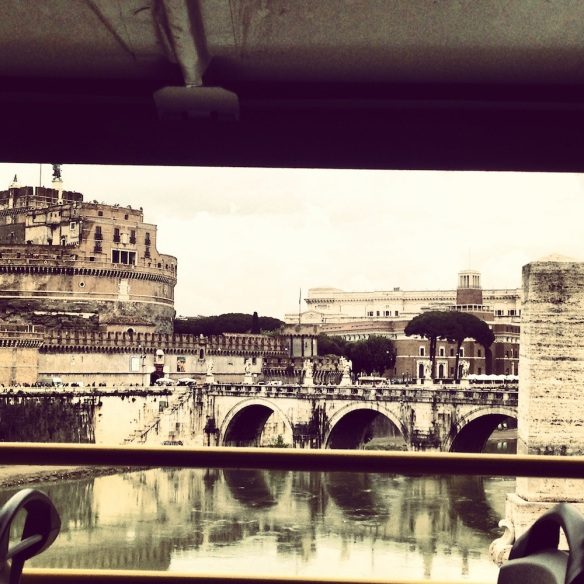 an iphone photo of st angelo in rome with the colors of brown and green eartthy and natural