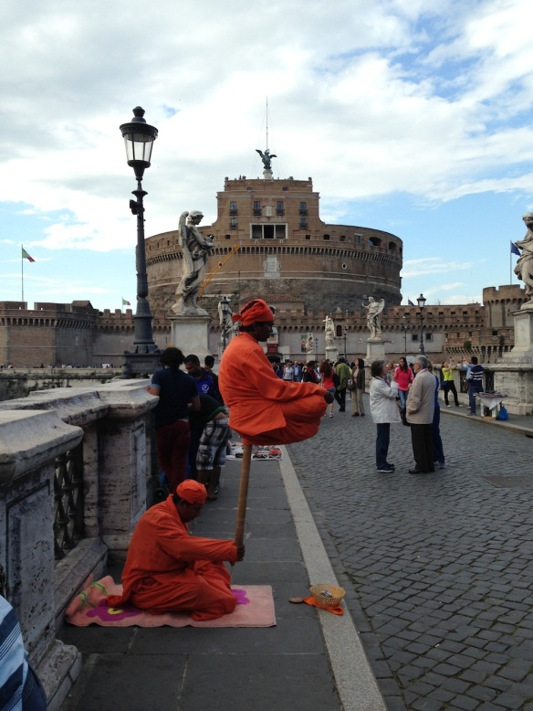 monks or Buddhists play meditation infront of the st.angelo with their orange outfit and turbans