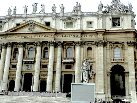 A photograph of the brilliant architecture of the vatican city in rome, the art of the church is magical