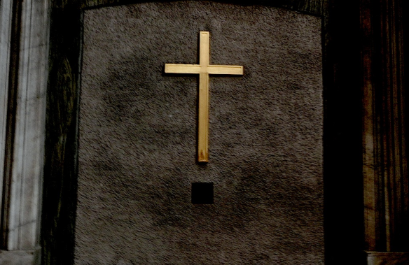 a picture of the golden cross inside the vatican in rome
