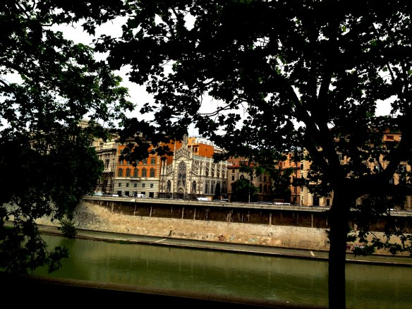 photo of trees river and architecture the beauty of rome italy travel