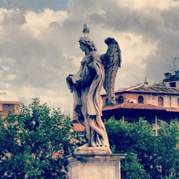 a far view of the bird on top of the saint angelo statue