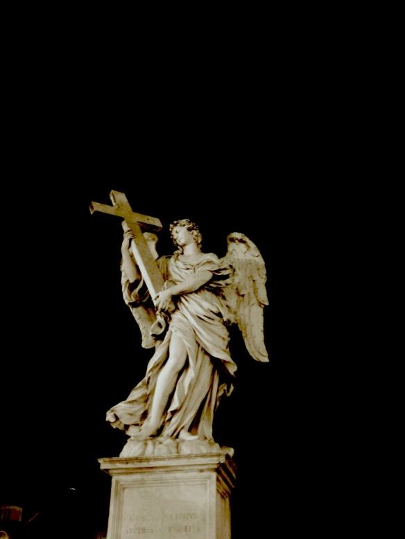 night scene with a statue holding the cross peacefully infront of the castel st angelo rome