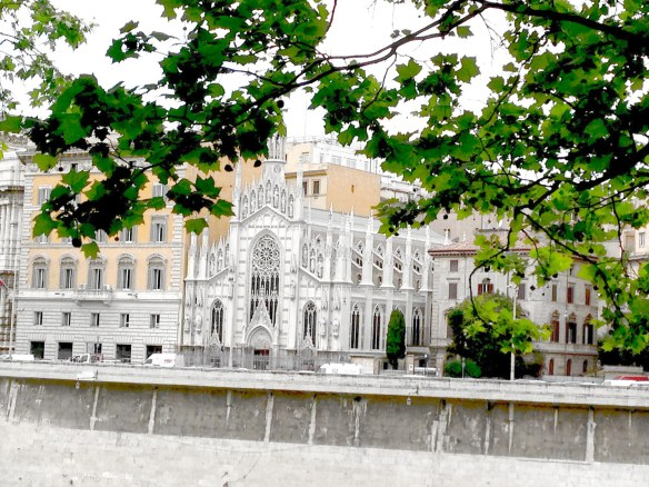 this photo reminds me of barcelona from the architecture of the church white between vintage buildings in roma