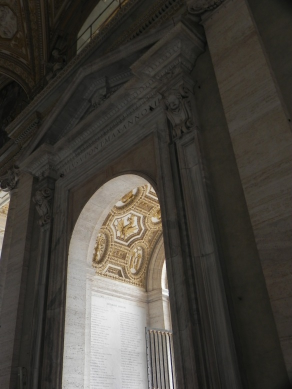 a picture of the door that takes you to the names of the pops at the vatican in gold