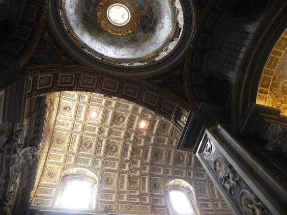 a stunning photo of the gold plates and architecture located inside the vatican