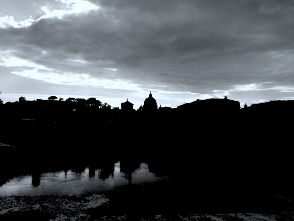 a beautiful sun dusk photo of vaticano from castel st angelo over the bridge and river