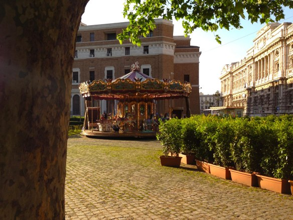 it is time for marry go round by the river tevere in rome on a stunning sunny day