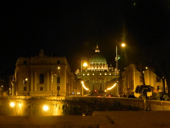 the vatican city at night with its lights under the moonlight