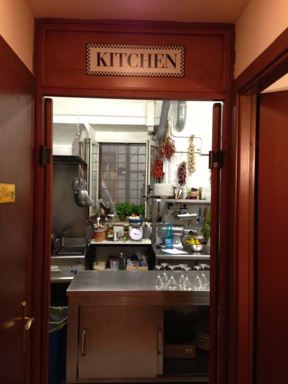 This is the door with entrance sign to Chef Andrea Kitchen in Rome