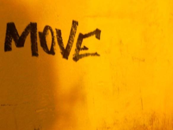 Move graffiti on wall in Rome