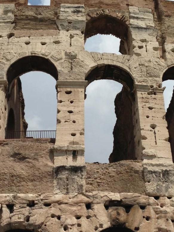close up photo of Piazza del Colosseo colosseum brick roma italia