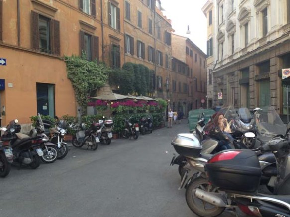 motorbikes scattered in the middle of the street of campo de'fiori