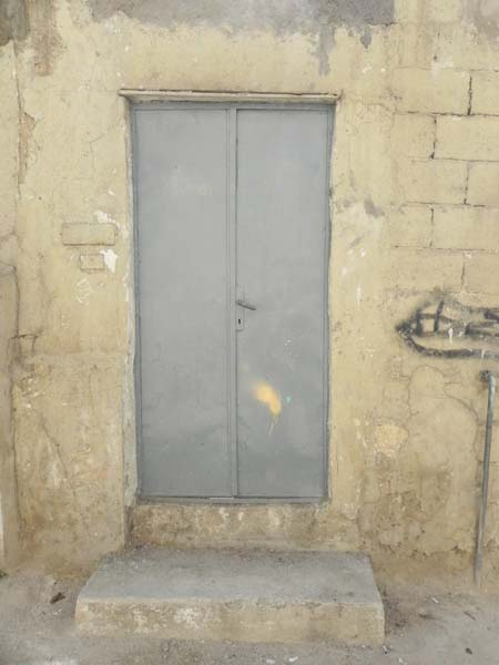 Grey door in the middle of a very old house Downtown Amman Al Balad