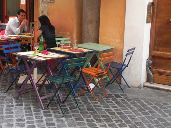 very funky colorful chairs of a restaurant located at the campo de'fiori