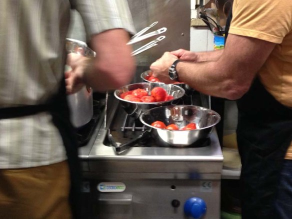Making Tomato sauce during Italian cooking class