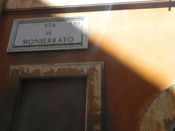 the street name sign on a wall in rome