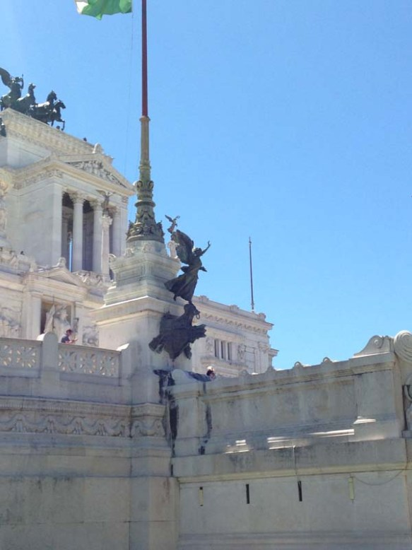 my favorite statue of an angel looking out at piazza venezia rome italy
