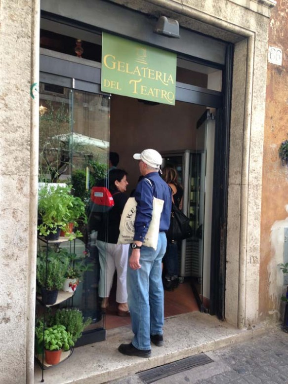 A man waiting to enter the Gelateria del teatro to buy icecream