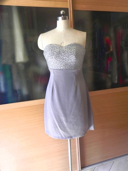 Silver short strapless dress designed by Razan Masri