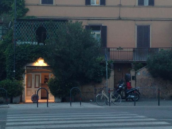 At Testaccio rome for dinner front picture of a restaurant and a bike