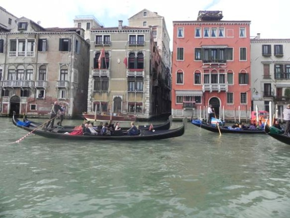 A gondola and a gondolier at the Grand Canal venice