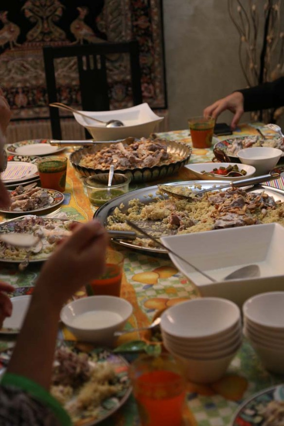 Jordanian Palestinian family having mansaf for dinner