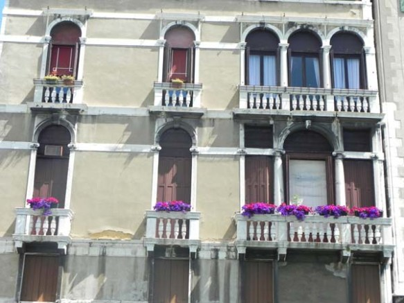 Architecture in venice is breathtaking specially with the beautiful cute little windows and decorations art is in everything purple fuscia flowers