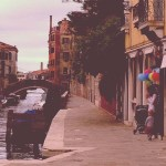 Mother child balloons infront of a shop in venice venezia grand canal love