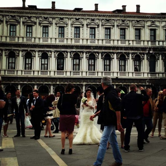 A bride in between all the people and tourists in piazza saint marco