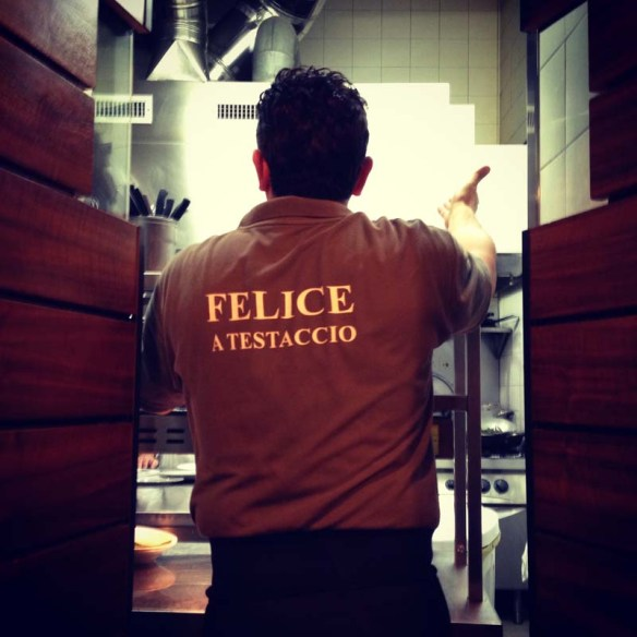 A waiter wearing a Felice uniform while serving food