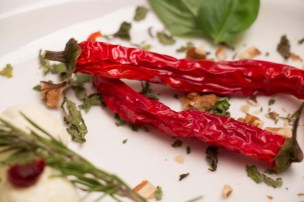 A picture of 2 chillies and some rosemary