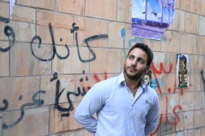 A male model infront of brick at old town downtown Amman