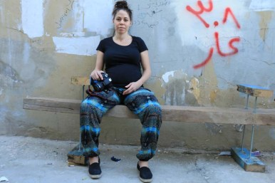 Pregnant participant yasmine posing street shot