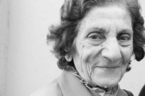 Old jordanian woman posing with wrinkles and close up look into her personality