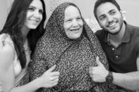 Black and white hijabi woman with 2 models thumbs up photograph