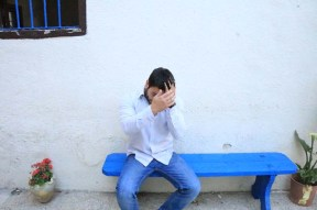 Blue bench with model sitting at Jadal culture
