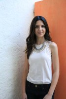 Model leen from modelicious posing with orange door as background