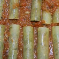 Cannelloni with minced meat cheese olives basil and tomatos