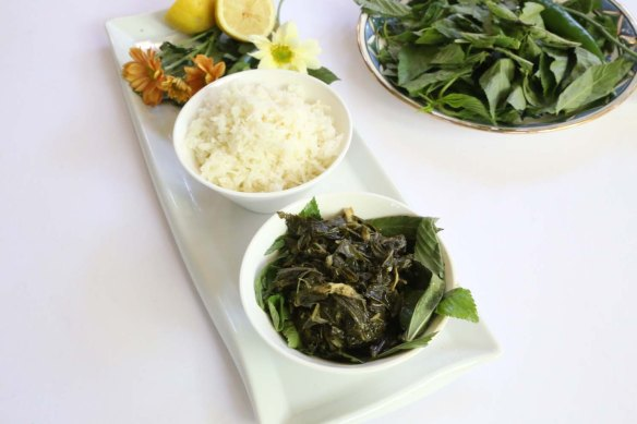 A Middle-Eastern Aranian dish Mulukhiah Mloukhieh green leaves vegetables with rice