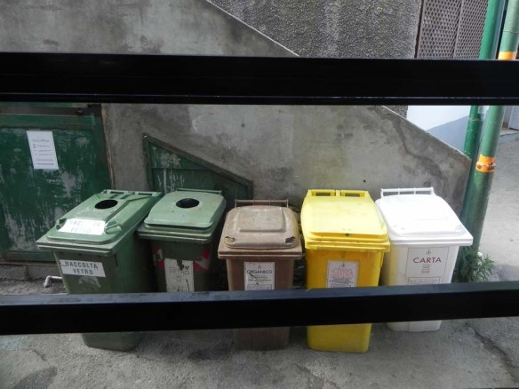 Capri Italy sequence of colored garbage bins