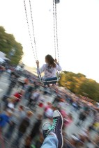 Swinging flying above people