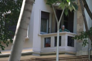 An old woman looking out the window