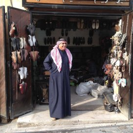 Al Salt, AsSalt, Al-Salt, AlSalt, Jordan، مدينة السلط الاردن, ancient city and architecture, a Jordanian man welcoming us into the small shoe shop
