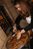 Making Musakhan a Palestinian traditional dish