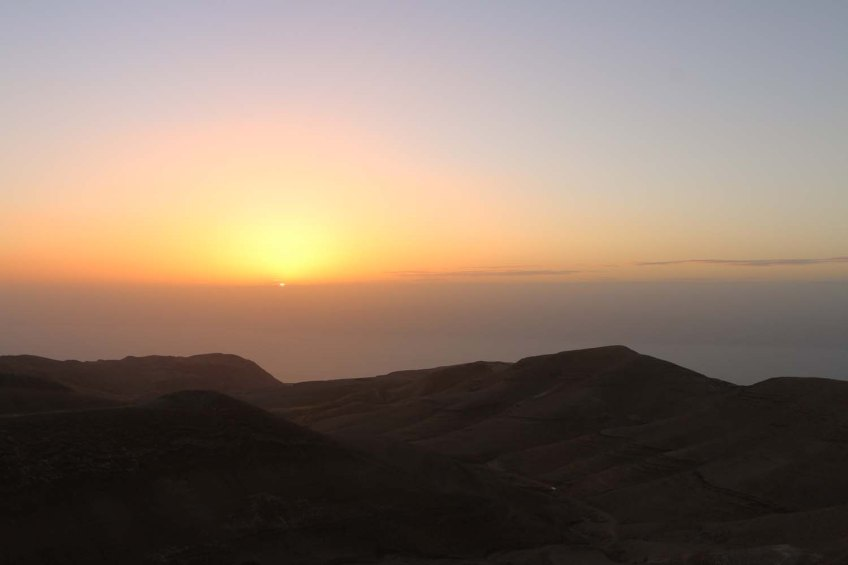The historic ancient attraction in Jordan of the Mukawir Fortress Sunset
