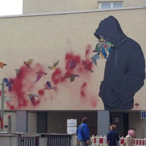Graffiti with man blowing butterflies from his mouth