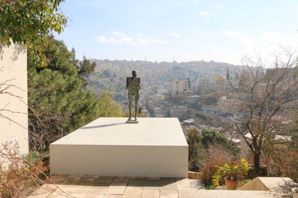 A statue of a man overlooking Amman Jordan